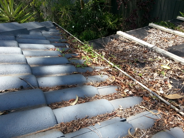 Blocked up tile gutters