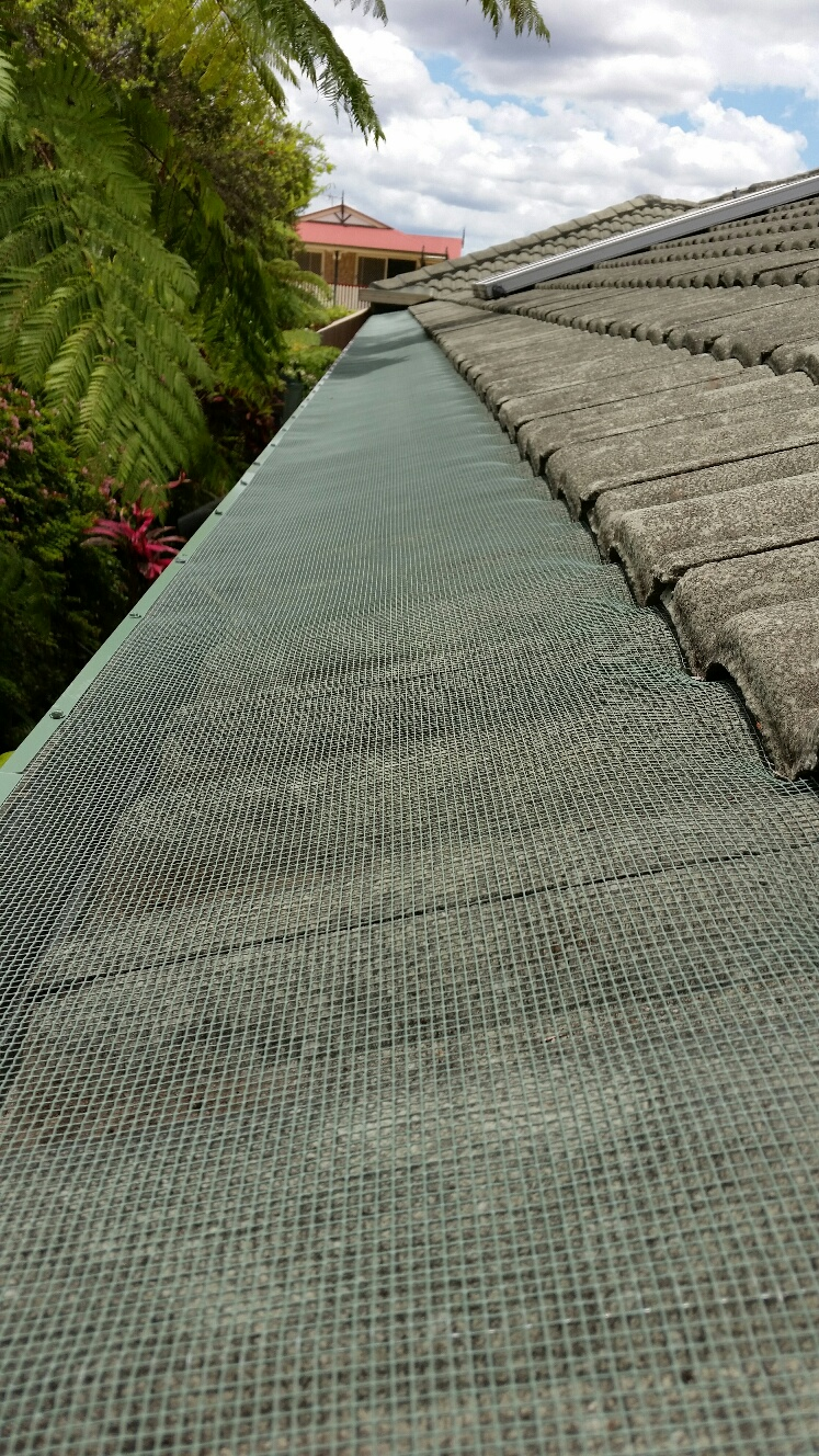 Steel gutter guard on Tile