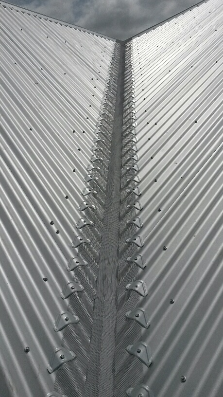 Valley gutter guard on corrugated roof