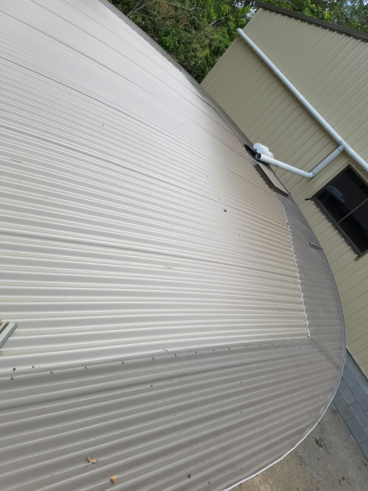Gutter mesh installed on a commercial water tank