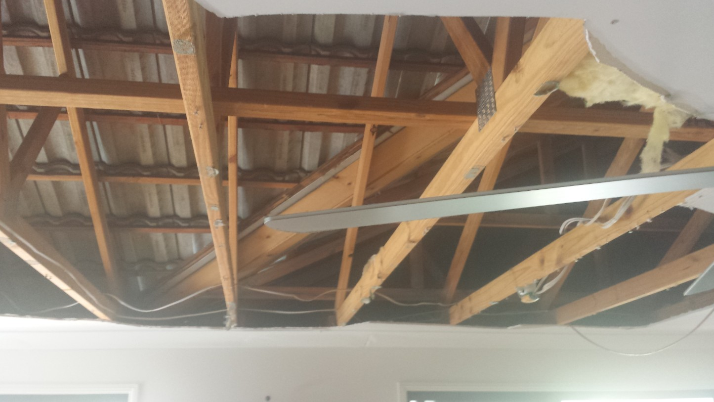 damage caused by a blocked up valley resulted in the ceiling having to be replaced